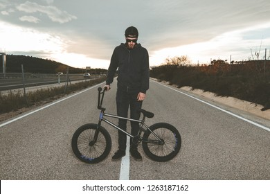 Young man with a bmx bike. BMX rider. Extreme urban sports concept