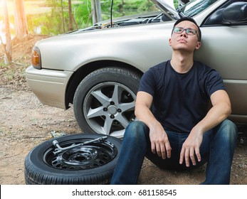 Young man broken car problem can not changing wheel tired
