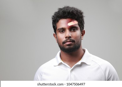 Young man with a bruised forehead