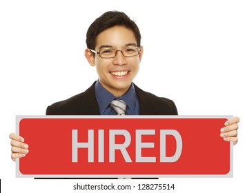 A young man in business attire holding a sign indicating hired