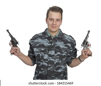 Young man in camouflage shirt with hand guns