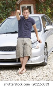 Young man with car
