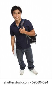 Young man carrying books and a backpack