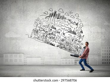 Young man carrying his great business plan in hands