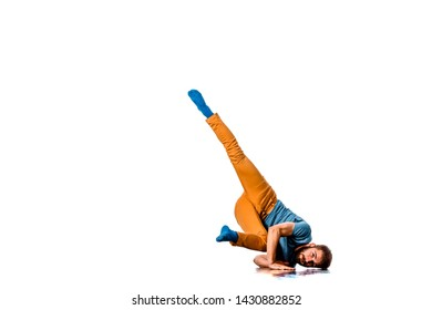Young man in casual clothes is making a handstand isolated on white studio background