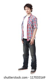 Young man in casual clothes posing over white background.