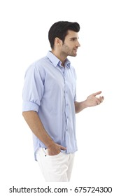 Young man in casual clothes turning left, talking, gesturing.