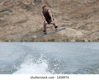 Young Man Catching Air on a Wakeboard