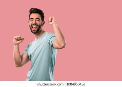 young man celebrating and dancing