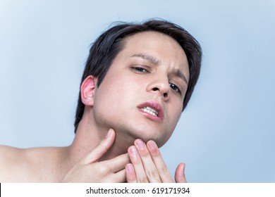 young man checking his facial skin. men's skincare concept.