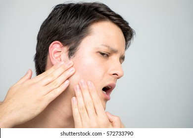 Young man checking his skin, men's skincare concept, acne treatment