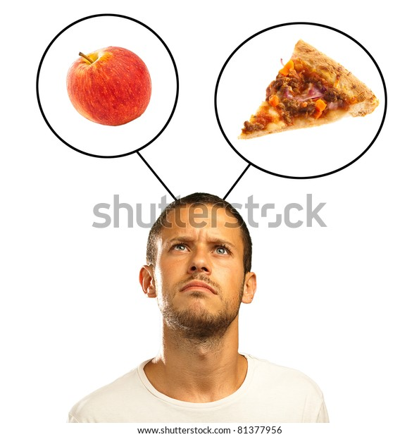 young man choosing between pizza and apple on a white background
