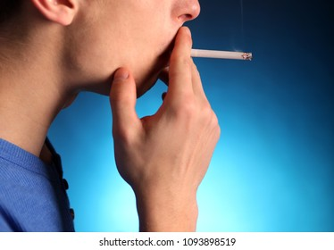 Young Man with Cigarette in the Dark Room closeup