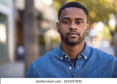 Young man in city serious face portrait