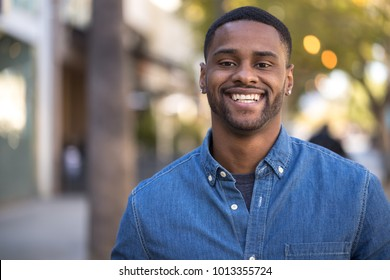 Young man in city smile happy face portrait