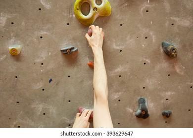 Young man climbing indoor