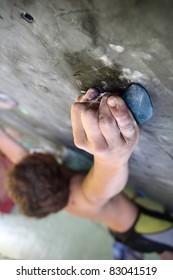 Young man climbing indoor wall