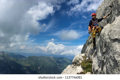 Young man climbing on a rock in Swiss Alps - via ferrata/klettersteig