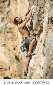 Young man climbing on a wall