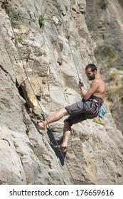 Young man climbing. Rock climber.