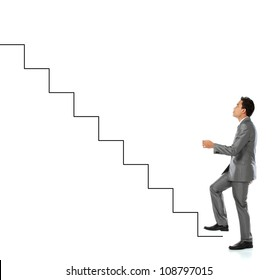 Young man climbs the stairway of success