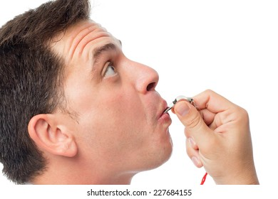 Young man close up over white background. Using a whistle