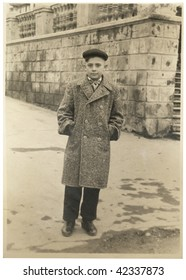 The young man in a coat and cap. USSR 1950s 20 century