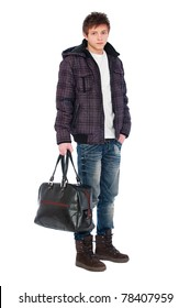 young man in coat holding bag. isolated on white background