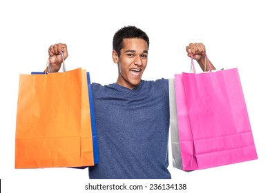 Young man with colourful shopping bags. Studio shot on white background.