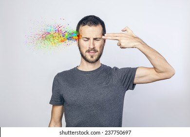 young man committing suicide with finger gun gesture, explosion of colors