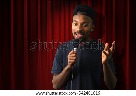 young man in concert red theater comedy vocalist singer microphone