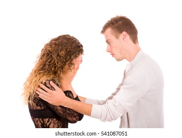 young man consoling his girlfriend, because she is crying isolated on white background