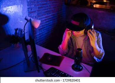 Young man content creator streaming virtual meeting