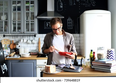 Young man cooking lunch in the kitchen