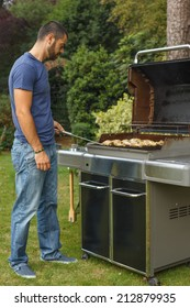 Young man cooking on the barbecue grill
