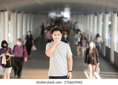 Young man coughing and chest pain He wears a mouth mask to protect against viruses and germs during the Coronavid-19 virus pandemic around the world.