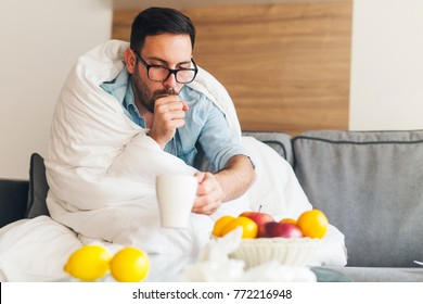 Young man coughing and suffering from cold