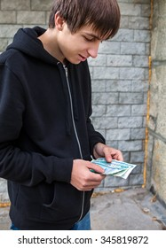 Young Man count the Russian Currency outdoor