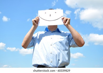The young man covered his face with a sheet of paper with a picture
