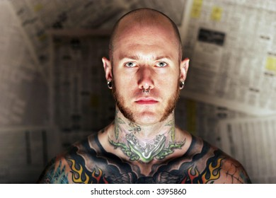 Young man covered in tattoo