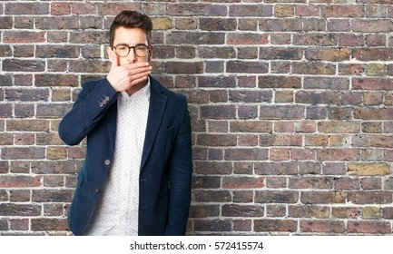 young man covering mouth