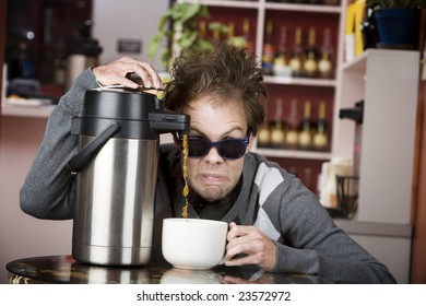 Young man crazily pouring coffee from a thermos in a cafe