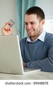 Young man with credit card on his laptop