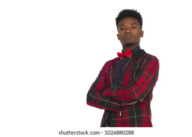young man crossed arms plaid jacket bowtie studio white background