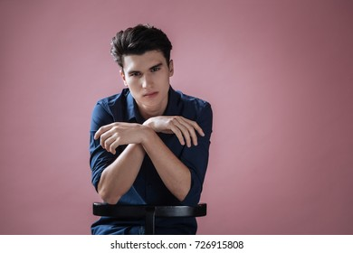 Young man crossing arms on camera