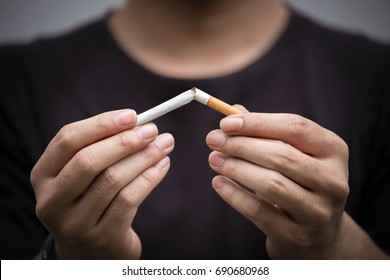 young man crushing cigarette.concept for breaking and quite cigarette for health
