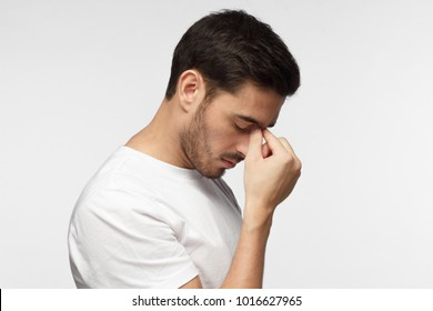 Young man crying about his failure, feeling bad about unpleasant situation. Negative emotion concept.