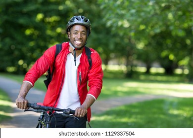 young man cycling in the park