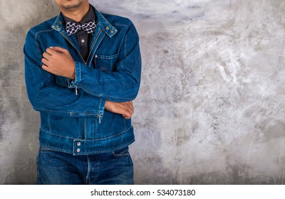 Young man Denim blue jean jacket. Background wall. for design denim fashion. Retro style
