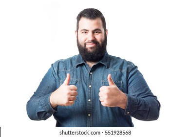 Young man with denim shirt making like gesture isolated on white background